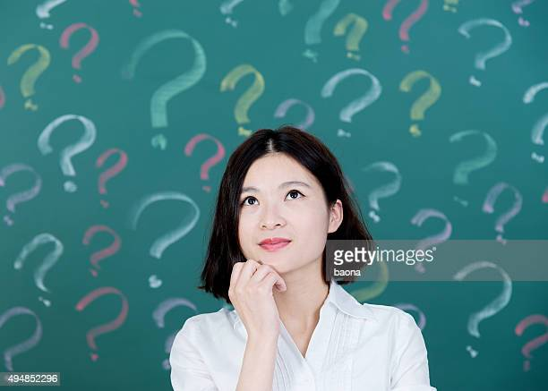 young woman with question mark - questions stock pictures, royalty-free photos & images