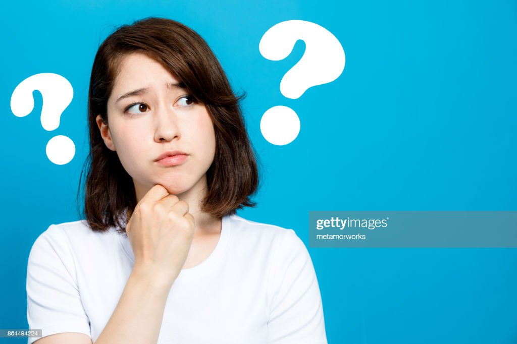 young woman with question marks. : Stock Photo