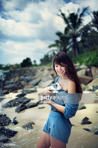young woman with rabbit - rabbit beach stock photos and pictures