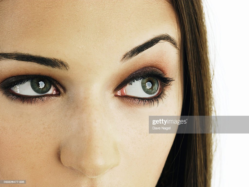 Young Woman With Raised Eyebrow Closeup Stock Photo Getty Images