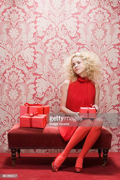 Young woman with red gifts