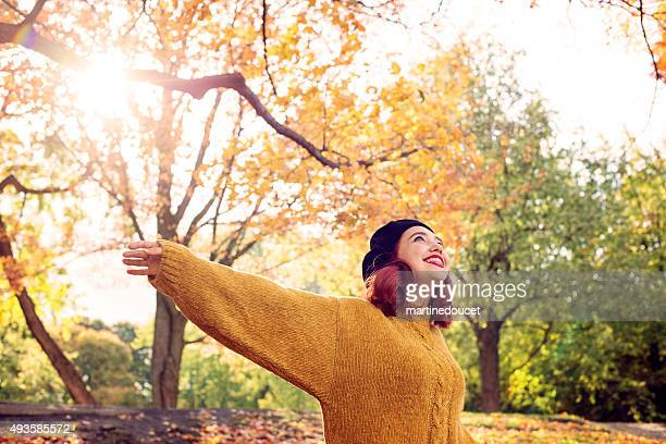 "young woman with red hair enjoying autumn colors with sunflare. - ""martine doucet"" or martinedoucet bildbanksfoton och bilder"