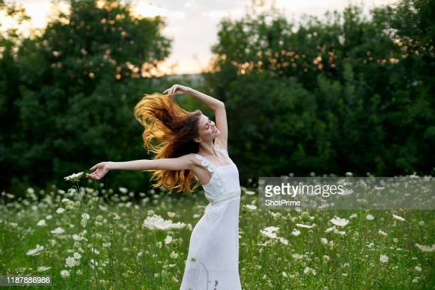 young woman with red hair in beautiful white dress outdoors - green dress stock pictures, royalty-free photos & images