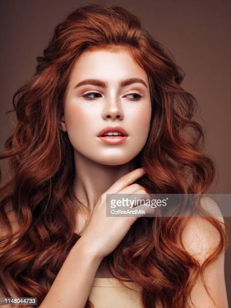 young woman with red hair - wavy hair stock pictures, royalty-free photos & images