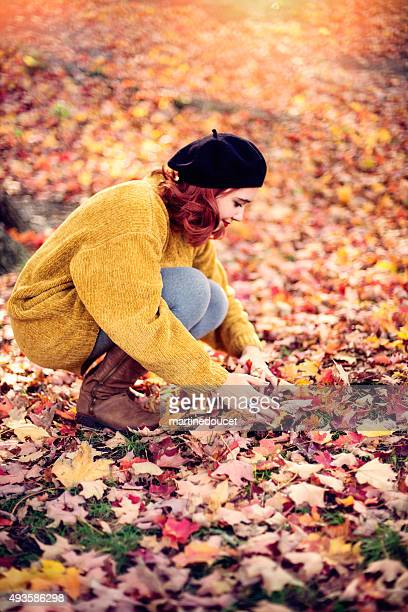 "young woman with red hair playing in autumn leaves. - ""martine doucet"" or martinedoucet bildbanksfoton och bilder"