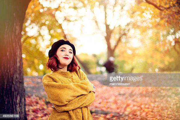 "young woman with red hair posing in autumn leaves. - ""martine doucet"" or martinedoucet bildbanksfoton och bilder"