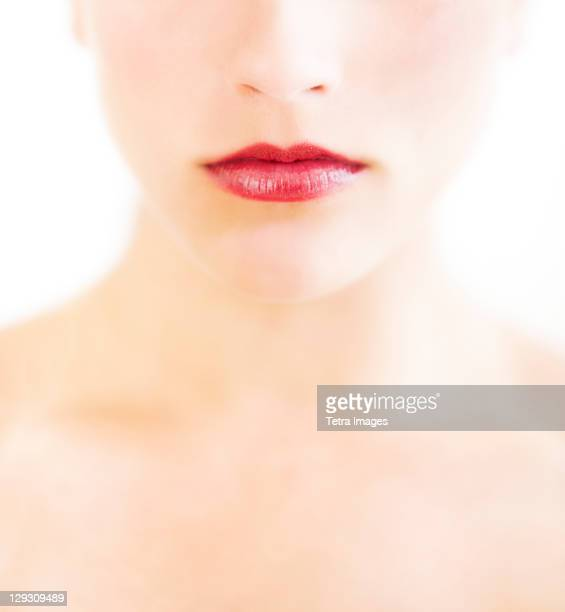 Young woman with red lips and pale complexion