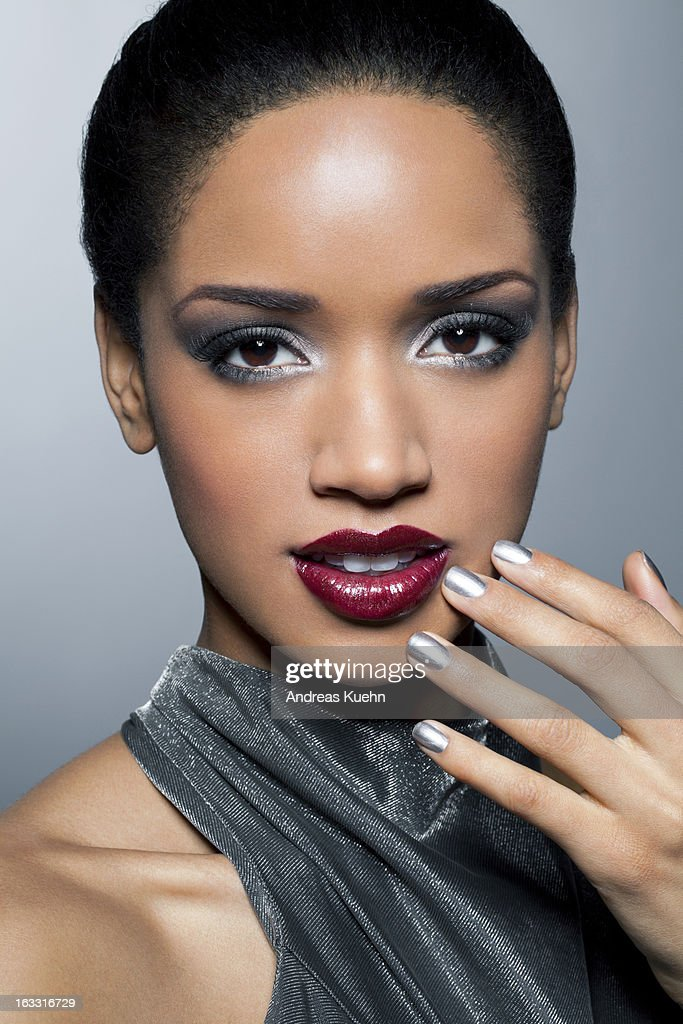 Young woman with red lips and silver nail polish. : Stock Photo