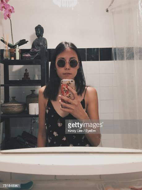 Young Woman With Reflection In Mirror