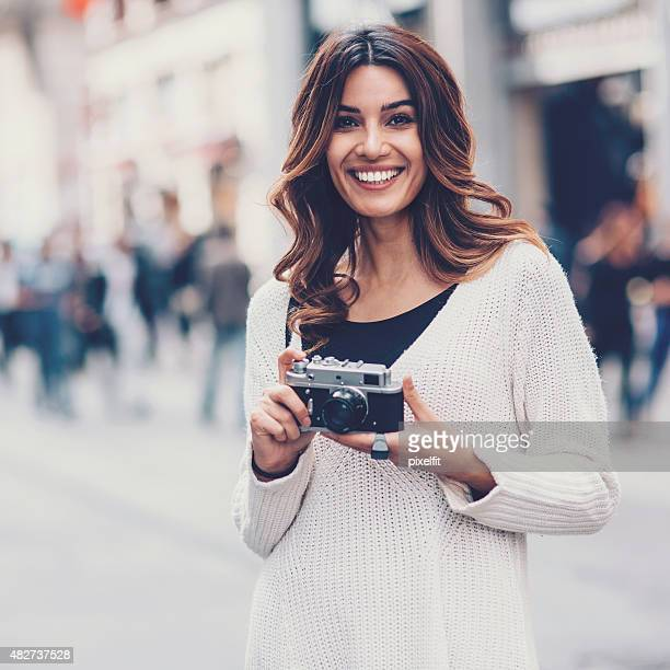 Young woman with retro camera outdoors
