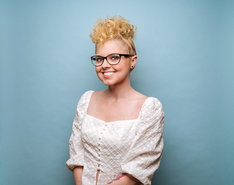 Young woman with retro hair and glasses - gettyimageskorea