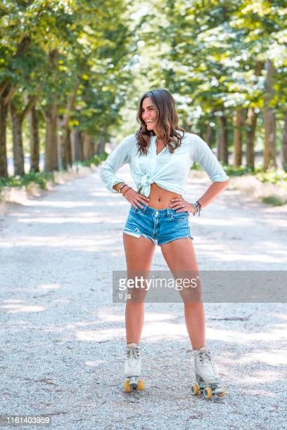 young woman with roller skates in nature - ferrara stock pictures, royalty-free photos & images