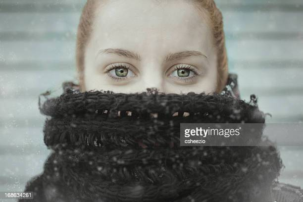 Young woman with scarf to protect from cold