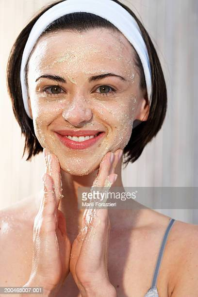 young woman with scrub on face smiling, portrait, close-up - exfoliation stock pictures, royalty-free photos & images