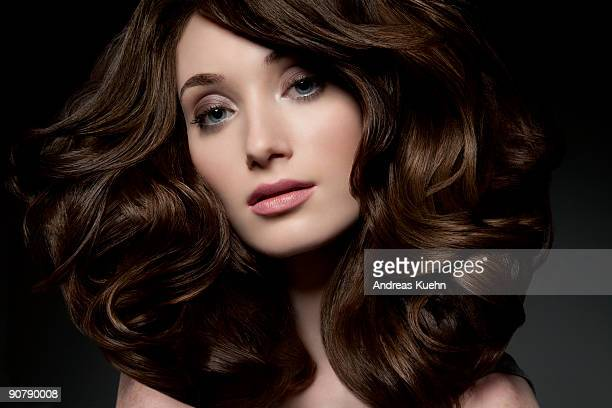 young woman with shiny thick hair, close up. - wavy hair stock pictures, royalty-free photos & images