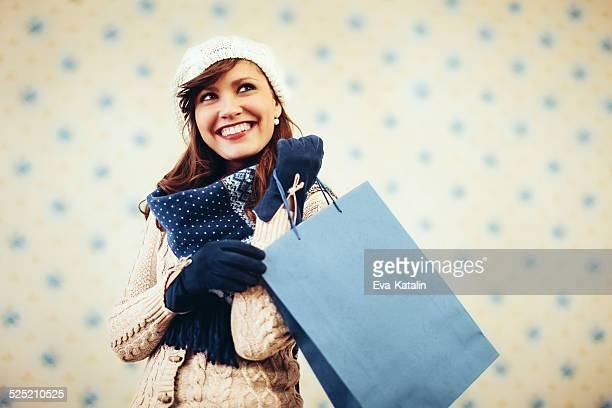 Young woman with shopping bag