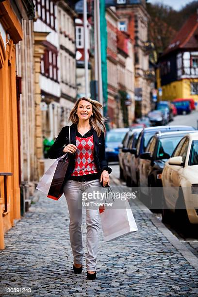 Young woman with shopping bags on the street