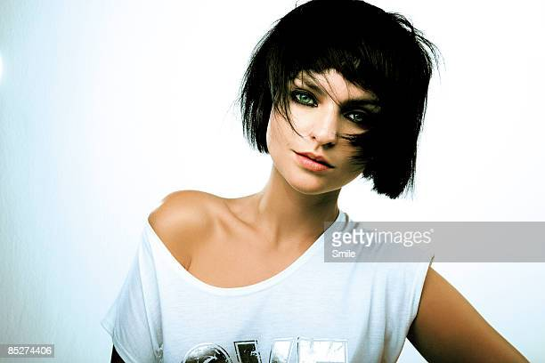 young woman with short black hair - bobbed hair stock pictures, royalty-free photos & images