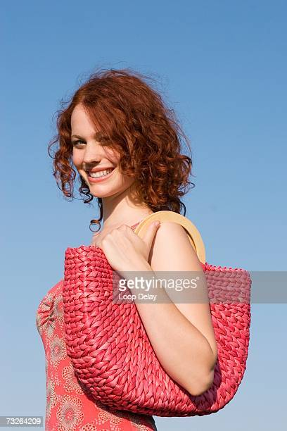 young woman with shoulder bag, side view, close-up, portrait - shoulder bag stock pictures, royalty-free photos & images