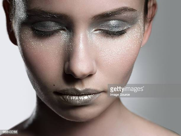 Young woman with silver make up on face