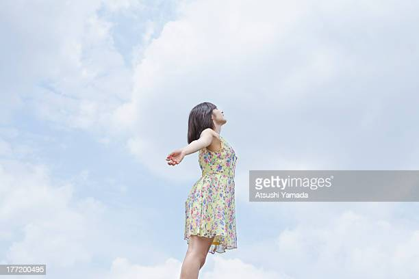 Young woman with sky background