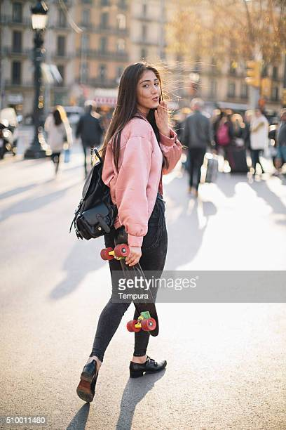 Young woman with smart phone in Barcelona, technology.