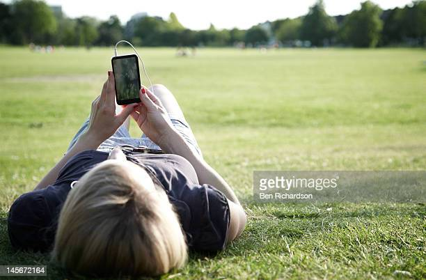 young woman with smart phone outside