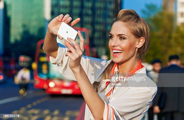 young woman with smart phone - izusek stock photos and pictures