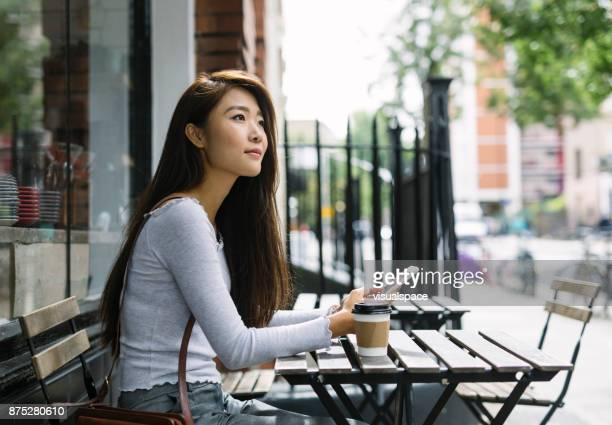 young woman with smartphone - donna cinese foto e immagini stock