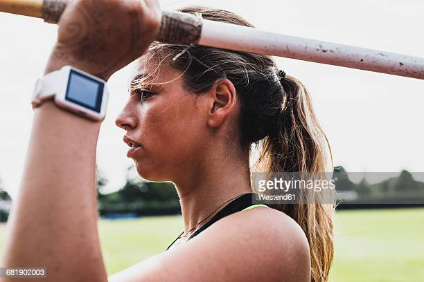 young woman with smartwatch holding javelin - women's field event stock pictures, royalty-free photos & images