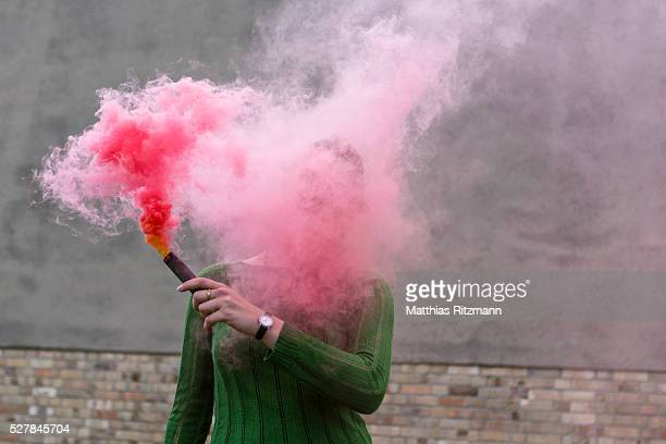Young woman with smoke