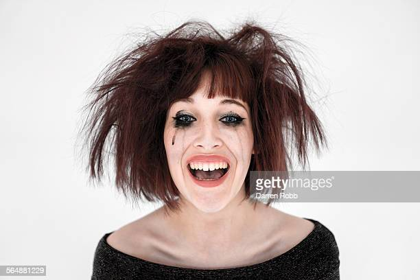Young woman with smudged make-up, laughing