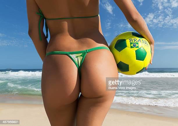 young woman with soccer ball on the beach - woman bum stock photos and pictures