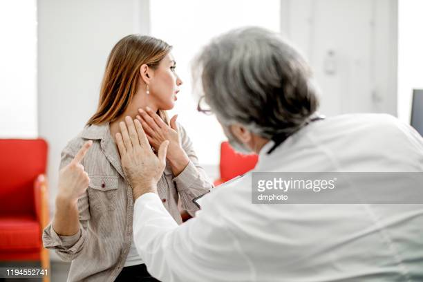 young woman with sore throat - thyroid gland stock pictures, royalty-free photos & images