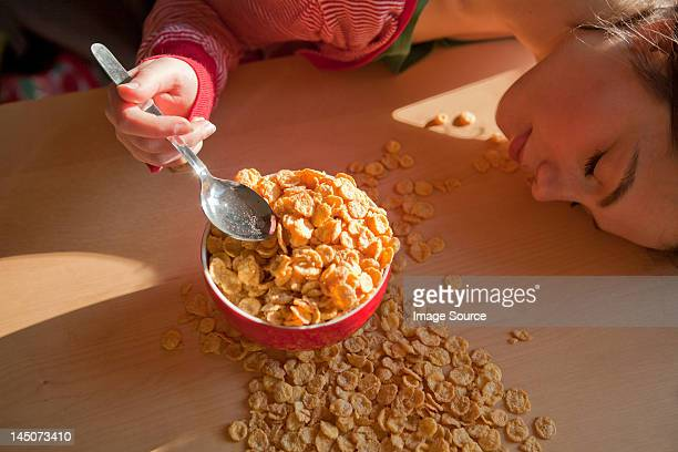 Young woman with spilt breakfast cereal