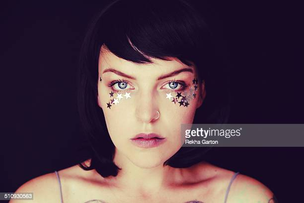 young woman with stars around her eyes - rekha garton stock pictures, royalty-free photos & images