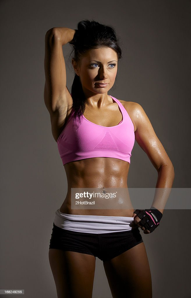 Young Woman with Sweaty Fitness Body : Stock Photo