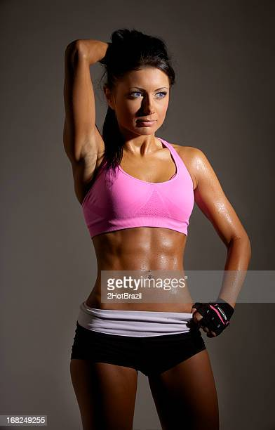 Young Woman with Sweaty Fitness Body