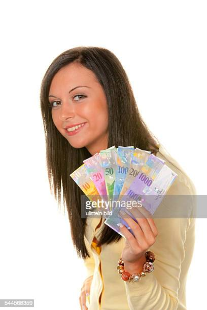 young woman with Swiss Franc banknotes