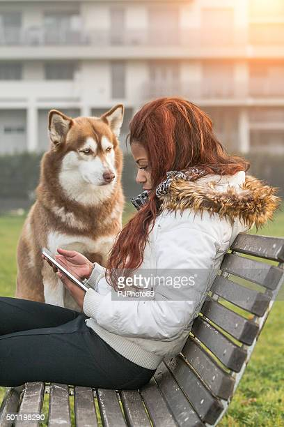 young woman with tablet and her dog - pjphoto69 stock pictures, royalty-free photos & images