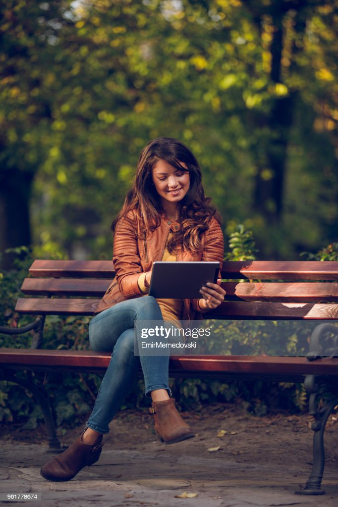 Young woman with tablet in the park : Stock Photo