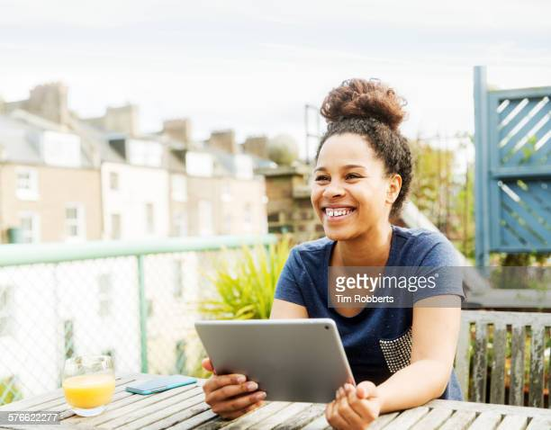 Young woman with tablet on terrace