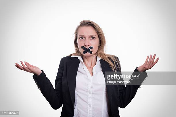 Young woman with tape on her mouth