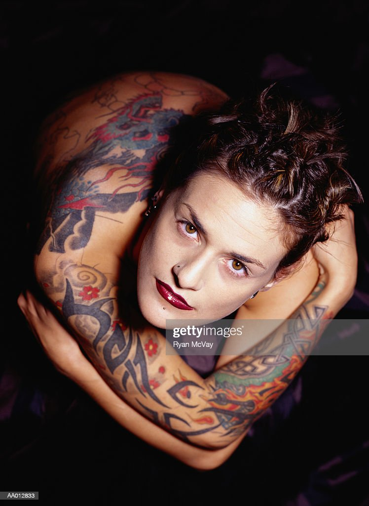 Young woman with tattoos, portrait, overhead view : Stock Photo
