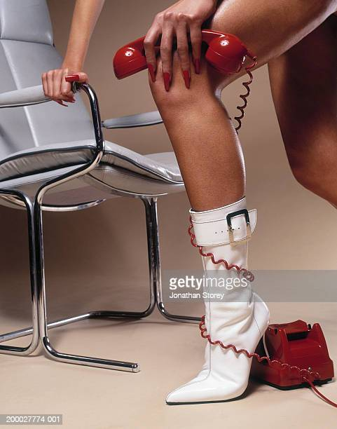 young woman with telephone cable wrapped around ankle, low section - bound in high heels stock photos and pictures