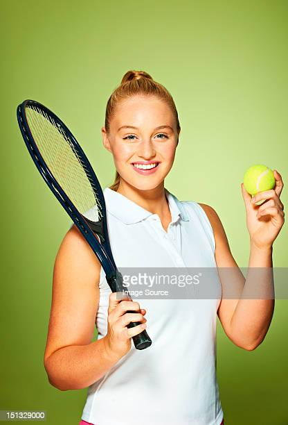 Young woman with tennis racket and tennis ball