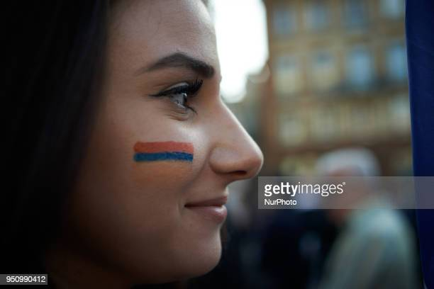 A young woman with the armenian flag on the cheek Armenians and Assyrians from Toulouse gathered for the commemoration of the 1915's genocide by...