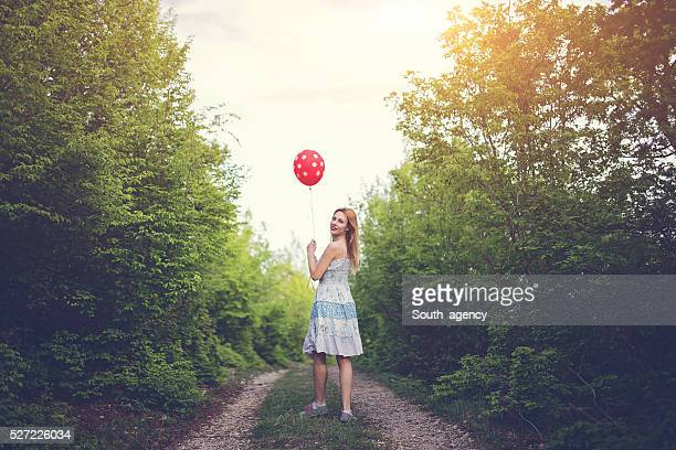 Young woman with the baloon