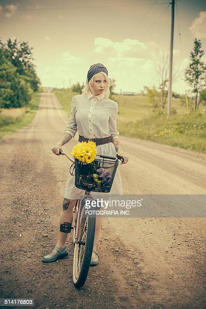 Young woman with the bicycle