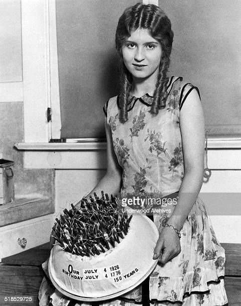 A young woman with the special birthday cake she made in honor of the 150th birthday of the United States Los Angeles California July 4 1926 What...